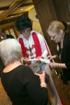 "Clem ""Elvis"" English Signing Autographs for Jeanne Heid and Julia Nicholas"